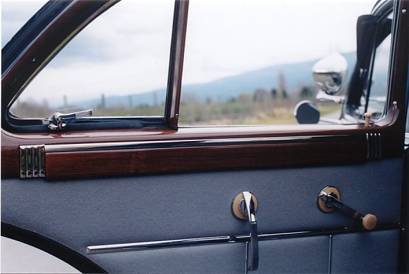 Rear door inside panel. Note window frames finished in beautiful imitation Wood paneling and rear opening vent windows.